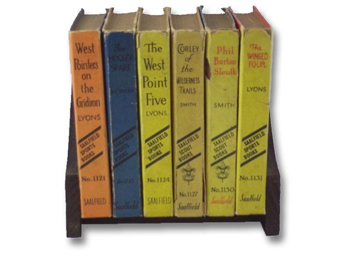 Six Volume Saalfield Boys' Adventure and Sports Series Set with Book Stand: West Pointers on the Gridiron; The West Point Five; The Hockey Spare; Corley of the Wilderness Trails; Phil Burton Sleuth; The Winged Four (Saalfield 1121, 1124, 1125, 1127, 1130, 1131), Lyons, Kennedy; Smith, Leonard K.; Sherman, Harold M.